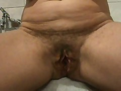 Ever wonder what an old hairy pussy looks like spread wide open?  Well now you don't have to wonder as this chick shows her loose hanging lips pulled apart for everyone to see inside her cunt.  If you're into big loose pussy lips, this one is for you as this video is all pussy, all open. The only thing missing is he asshole.